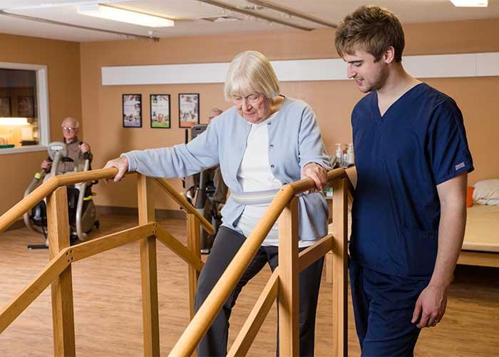 Nurse helps with rehabilitation