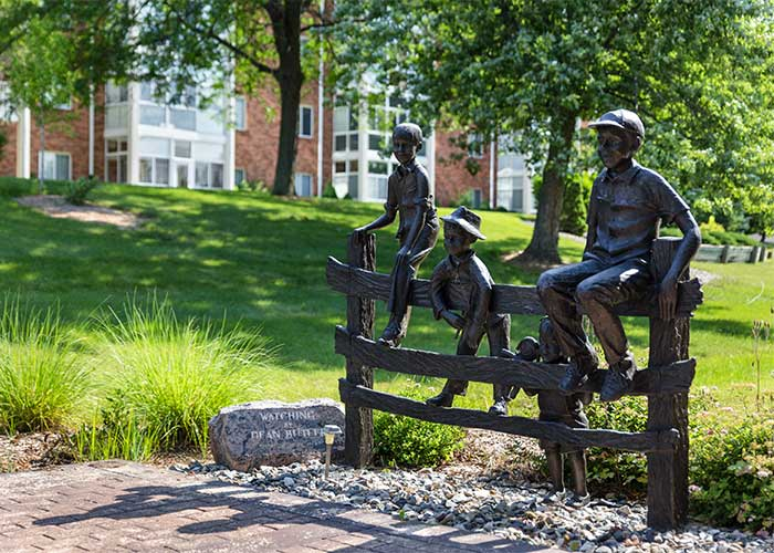The Towne House sculpture along walkway